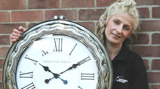 Karolina Olszanska with a clock made from NORMA Group products.