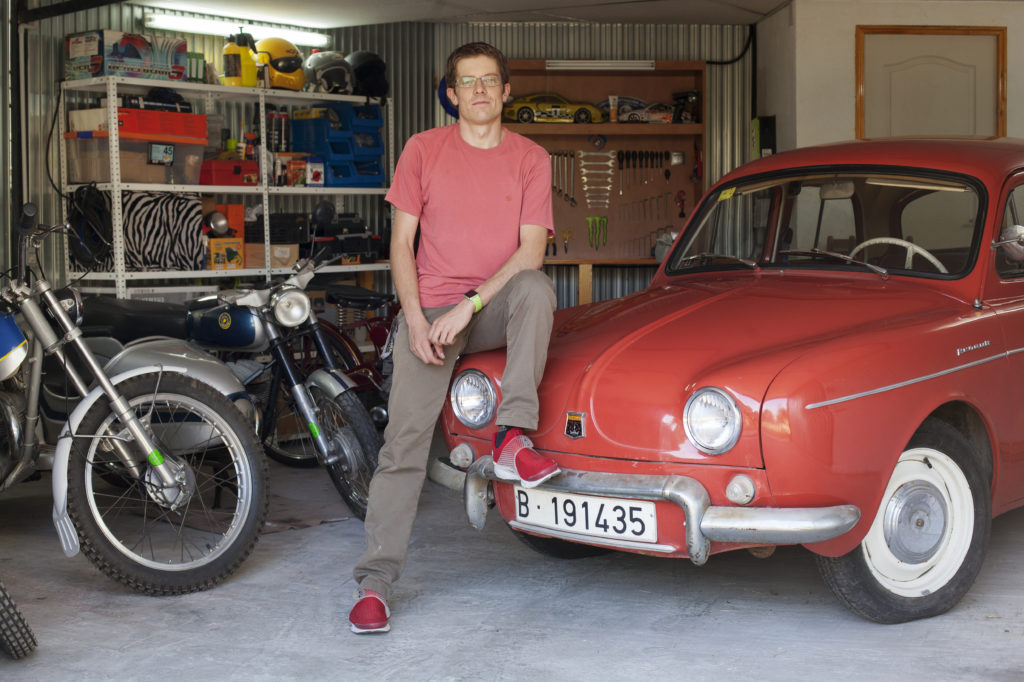 Daniel Quesada, Graphic Designer at NORMA Group, with his Renault Dauphine at his garage.