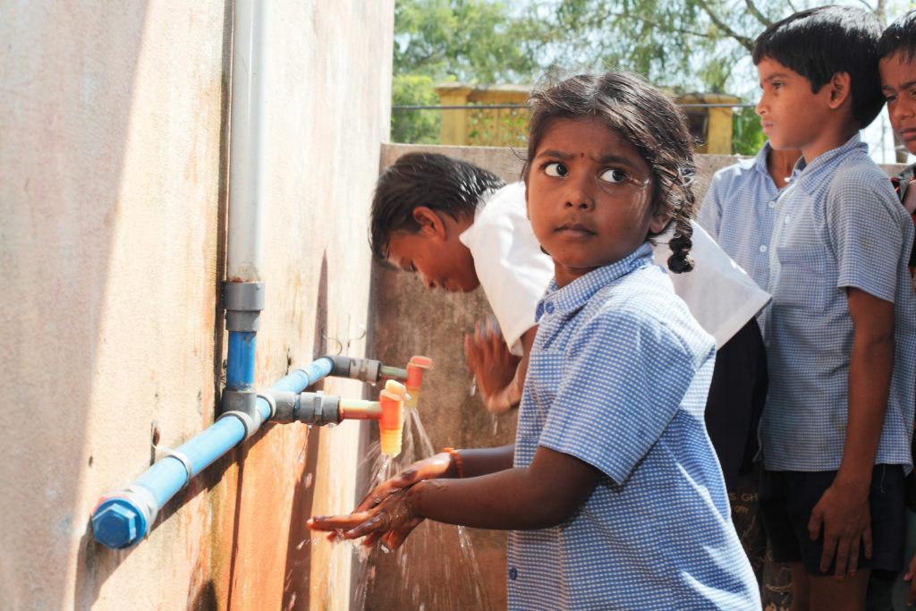 In India, Plan International and NORMA Group provide schools with intact water supply and sanitary facilities.