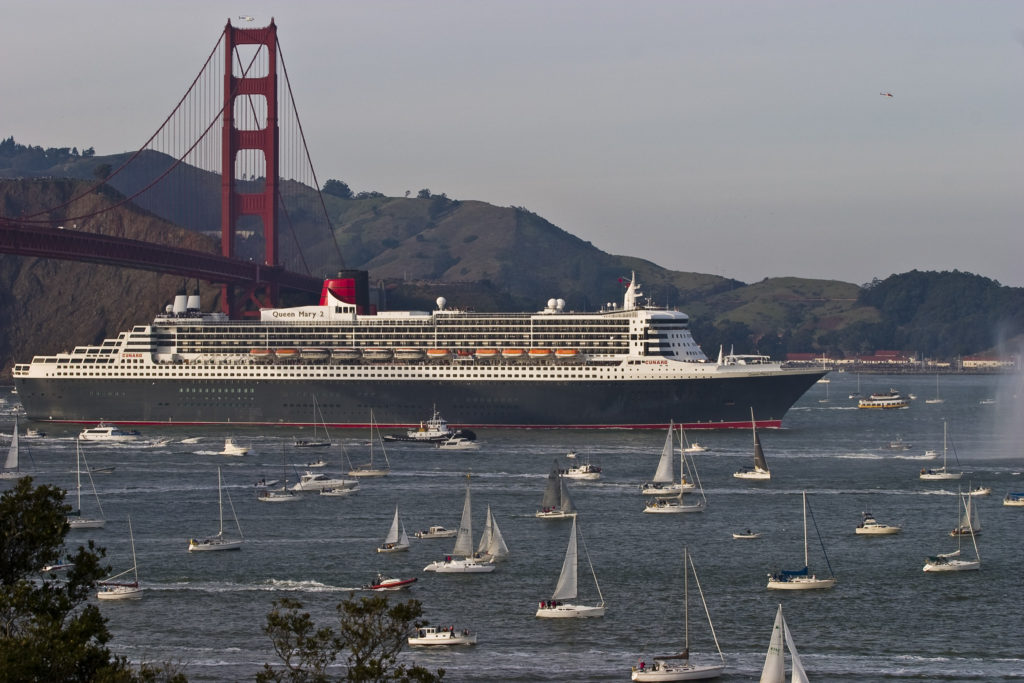 Countless ships and sailors welcome the Queen Mary 2 as she arrives in San Francisco.